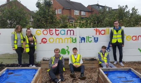 Student volunteers create community garden